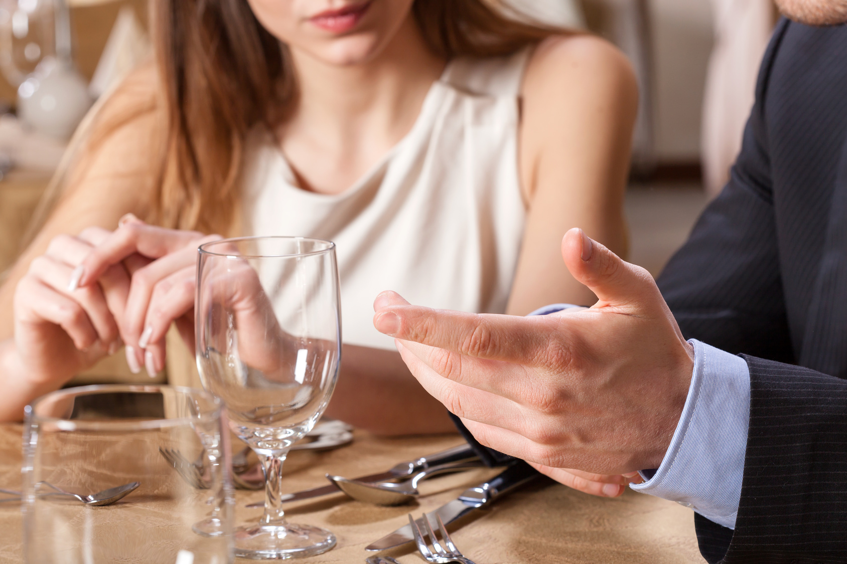 Couple dating on a dinner, closeup of a tableware