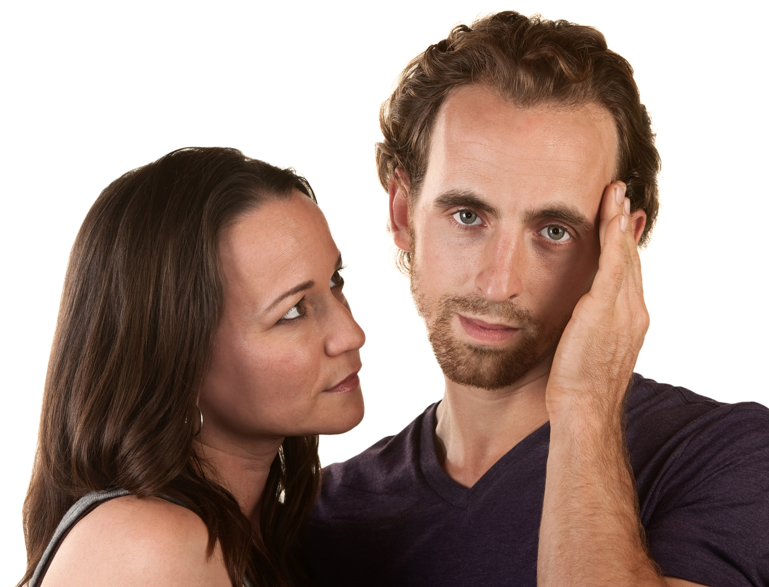 Sympathetic woman looking at man holding his head