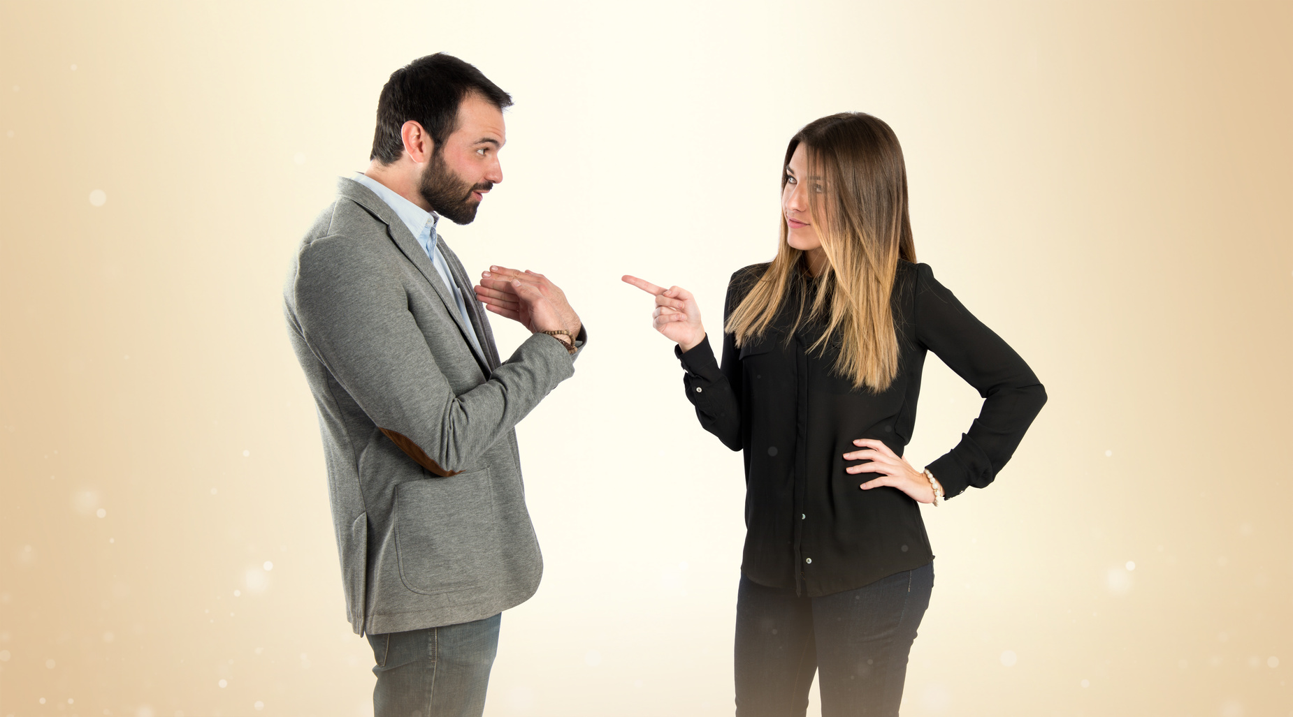 Girl pointing at her boyfriend over white background