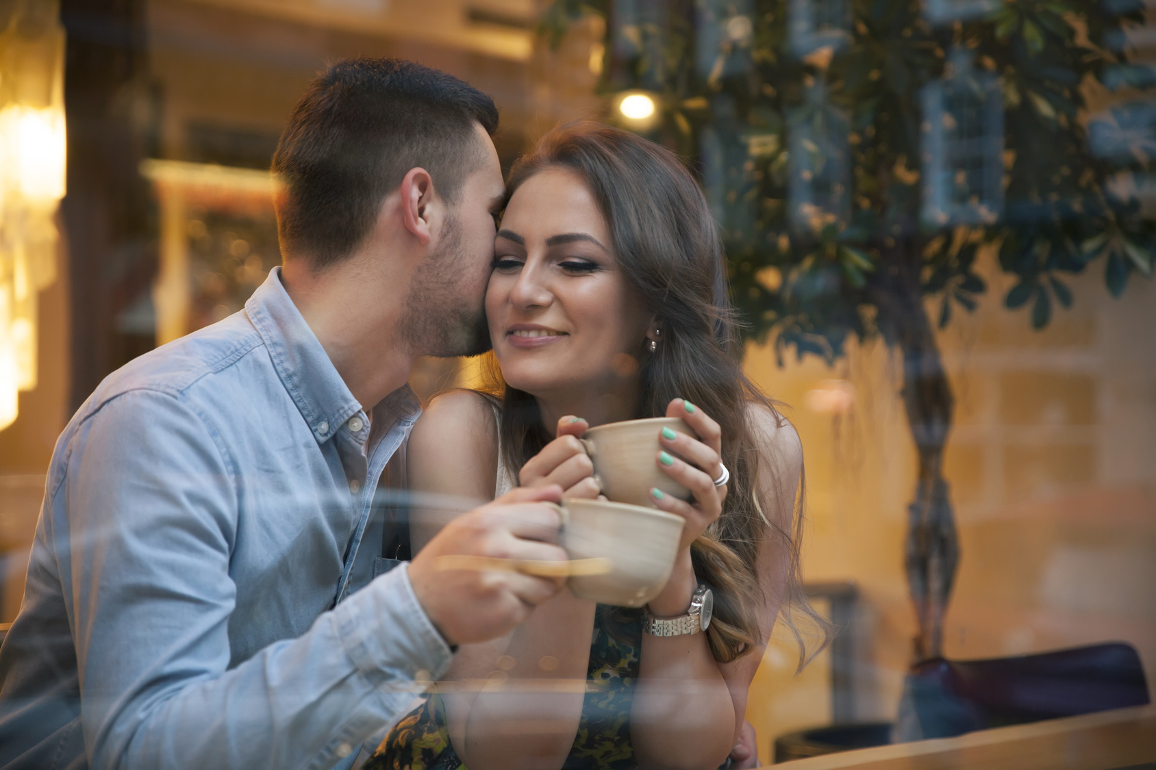 young couple flirting on a date in cafe