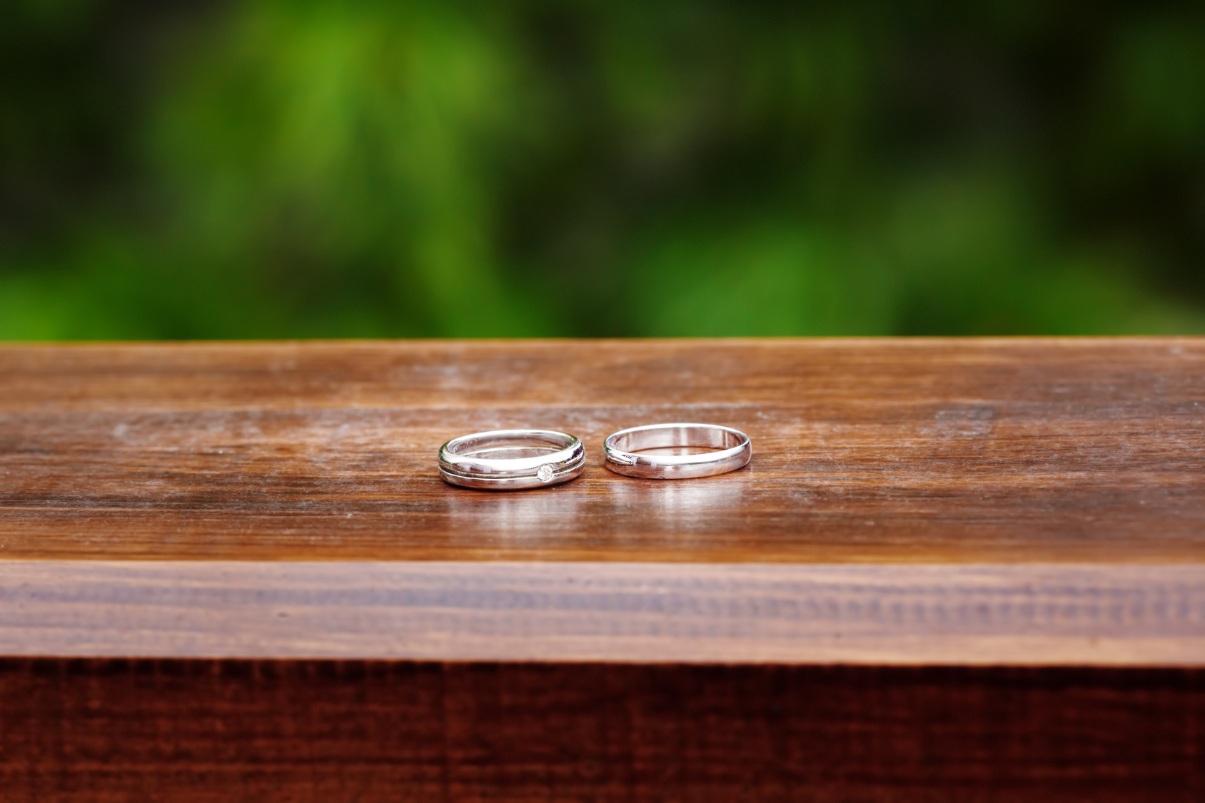 Wedding Engagement Rings Close up on Wood Background. Rustic Style decoration.
