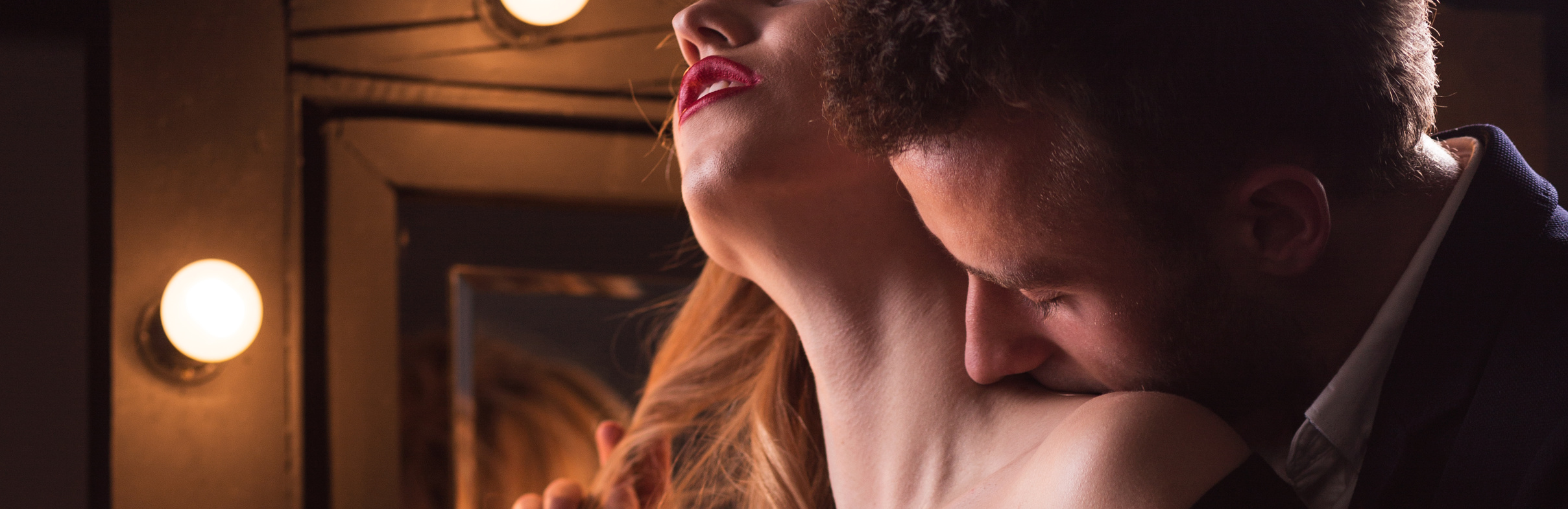 Man is kissing a woman in the neck